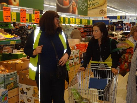 Volunteer shopping with a client