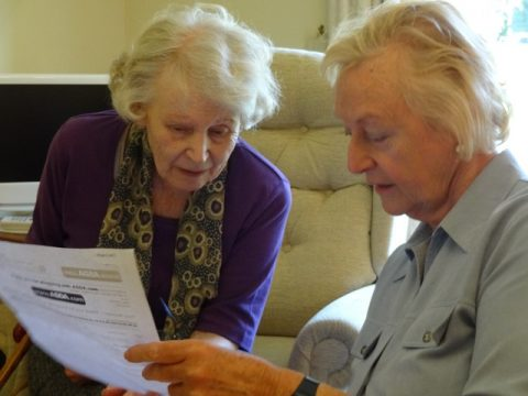 A volunteer reading to a client