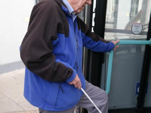 a man getting on a bus