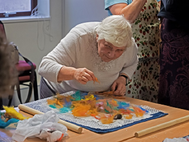 YBPSS member taking part in felting wool activity