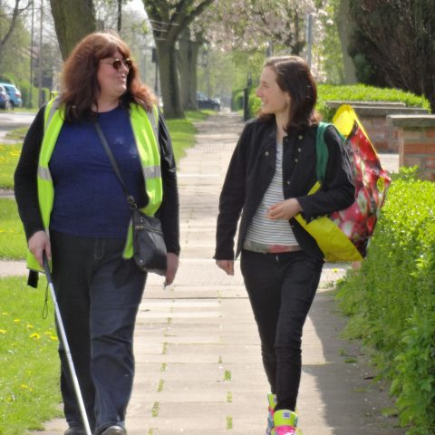 Volunteer and client out walking